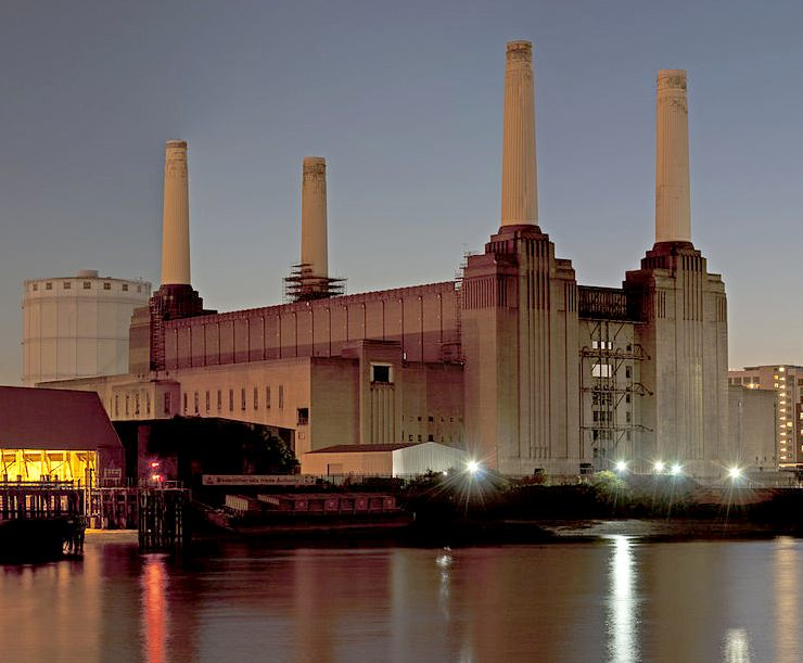Battersea power station at dusk, reflection across the River Thames, London